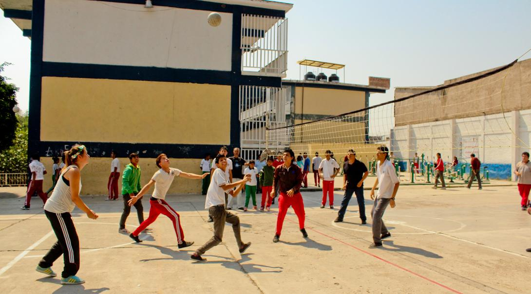 Projects Abroad volunteers play volleyball with the people at the refugee camp in Mexico.